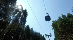 Gondola ski lift  in the pine forest, 4k steadicam Stock Footage