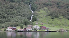 Waterfdall, small village  and ship passing by in  the Aurlandsfjord, Norway Stock Footage