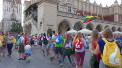 Young people singing and dancing in line on a crowded square - Krakow WYD 2016 Stock Footage