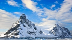 Snow-capped mountains in Antarctica. Slow motion 4K footage Stock Footage