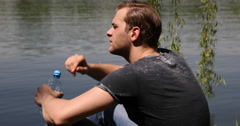 Handsome Young Man Drinking Water Hot Day Warm Temperature Park Lake Cute Person Stock Footage