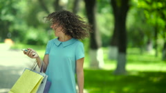 The girl shakes her head with curly hair. Stock Footage