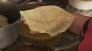 A woman prepares stuffed cabbage rolls with cabbage and meat at home kitchen Stock Footage