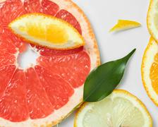 Background of citrus fruit slices, with lemons, oranges and grapefruit Stock Photos