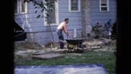 1960: men working with wheelbarrows and cement as well as shovel WAUCONDA Stock Footage