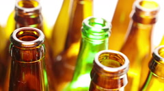 Bright red and green necks of bottles, the top view Stock Footage