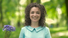 Beautiful girl with curly hair sneezes. Stock Footage