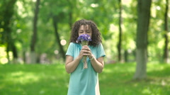 Girl smelling a bouquet of flowers. Stock Footage