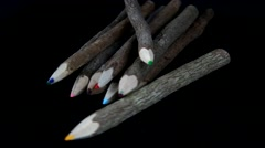 Rotating wood color pencils on black background Stock Footage