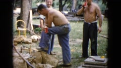 1960: group of men outside doing the yardwork WAUCONDA, ILLINOIS Stock Footage