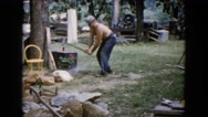 1960: men working with using a sledgehammer to crush a large rock WAUCONDA Stock Footage