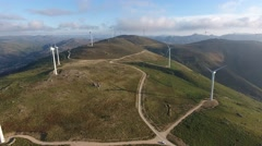 Eolic turbine wind renewable energy farm on top of mountain aerial shot 4k Stock Footage