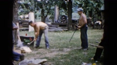 1960: man pretends to shoot rifle at laborer Stock Footage