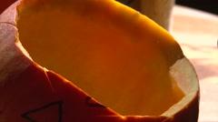 Carving the eye on little halloween pumpkin face, closeup shot Stock Footage