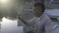 Man Takes A Panorama Photo Of Water In City Park Stock Footage