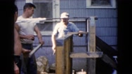 1960: enjoying a nice cold beer while working hard on a hot sunny day. WAUCONDA Stock Footage