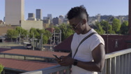 Man Texts, Puts Phone Down To Enjoy City Views From Pedestrian Bridge Stock Footage