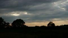 Tracking shot nature, silhouette trees and rays of light beaming through clouds Stock Footage