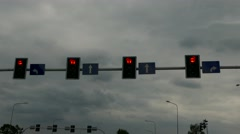 Tracking shot of traffic light from the car driver POV -from red to green and go Stock Footage
