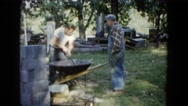 1960: construction workers mixing the concrete WAUCONDA, ILLINOIS Stock Footage
