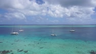 Panning over blue lagoon with few boats Stock Footage