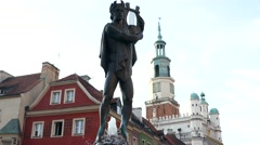 Poznan, Poland: A pan view of tourists visiting the Poznan town hall in old town Stock Footage