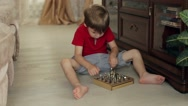 Boy Playing Chess Sitting on the Floor Stock Footage