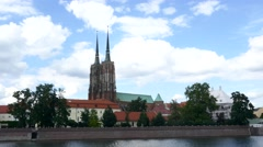 A pan long shot of the Cathedral of St. John the Baptist in Wrocław, Poland Stock Footage