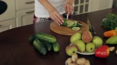 Woman Cuts Cucumber For Salad Stock Footage