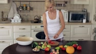 Woman Cuts Tomato For Salad Stock Footage