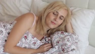 Woman Sleeping Lying on the Bed, Covered With a Blanket in the Bedroom Stock Footage