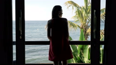 Young woman admire sea from terrace Stock Footage