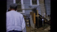 1960: worker walking with trolley of gravel and take out with shovel WAUCONDA Stock Footage