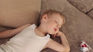 Boy Sleeping on a Sofa Among the Toys Plane Stock Footage