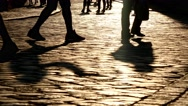 Legs of group of silhouette crowd of people walking in street with sunlight Stock Footage