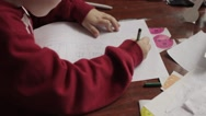 Boy Draws a Picture House, the Family, Sitting at the Table Stock Footage