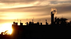 Silhouette factory in the city producing pollution, smoke-global warming concept Stock Footage