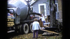 1960: workers stand beside a huge concrete mixing machine WAUCONDA, ILLINOIS Stock Footage