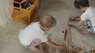 Two Brothers Playing in the Wooden Railroad House Stock Footage