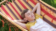 Boy Lying on a Hammock on a Nature Stock Footage