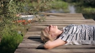 Woman Lying on a Wooden Pier Stock Footage