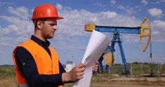 Young Worker Man Analyzing Oil Pump Project Sketch Petrochemical Industry Plan Stock Footage