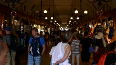 Krakow, Poland: Tourist shopping souvenir in Krakow cloth hall market Stock Footage