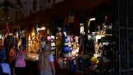 Krakow, Poland: Tourist shopping souvenir in Krakow cloth hall market Stock Footage