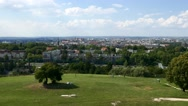 People sitting on top of a hill with a good view to the city and looking around Stock Footage