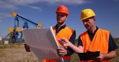 Engineer Men Working Pumpjack Examining Oil Pump Project Plan Teamwork Chat Stock Footage
