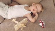 Boy Sleeping on a Sofa Among the Toys Plane Stock Footage