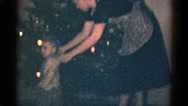 1959: mother help the children to decorate the x-mas tree with illumination Stock Footage