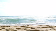 Little girl playing on the beach, running and jumping Stock Footage