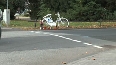 A ghost bike roadside memorial on the corner of a crossroads Stock Footage